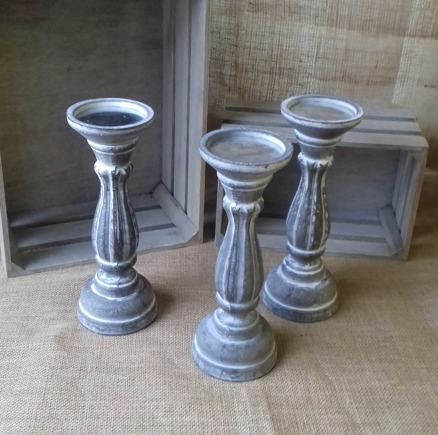 Grey wooden candleholders