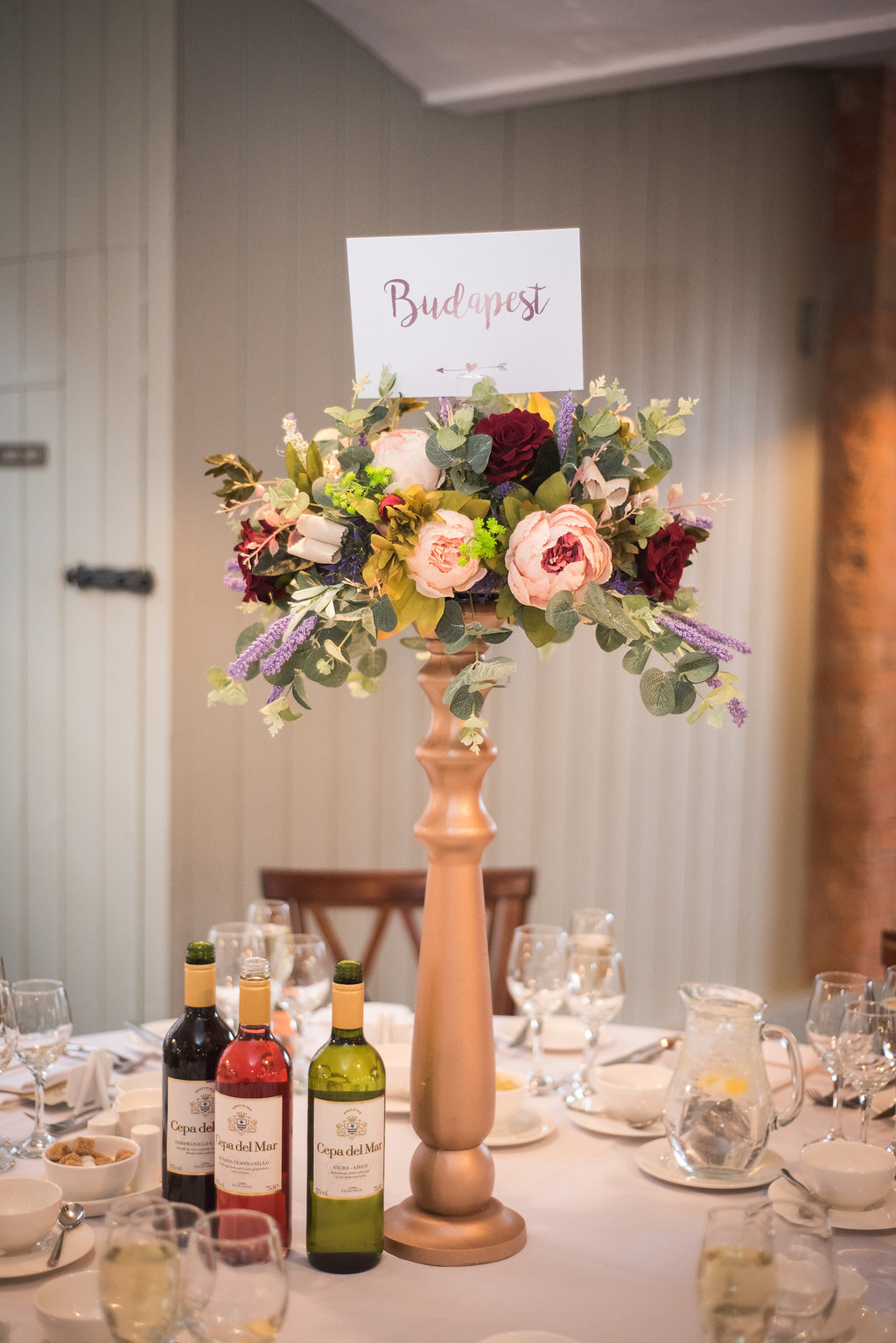 Copper and floral wedding centrepiec