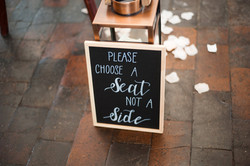take a seat not a sie sign