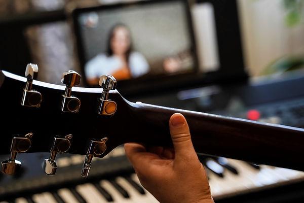 virtual guitar lesson. female musicians