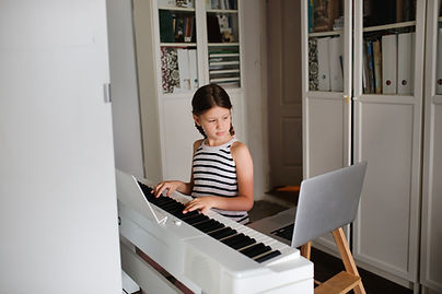 Remote music lesson, a child girl playin