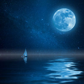 Lonely yacht in calm ocean, full moon an