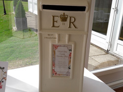 KMS Hire's cream and gold post box