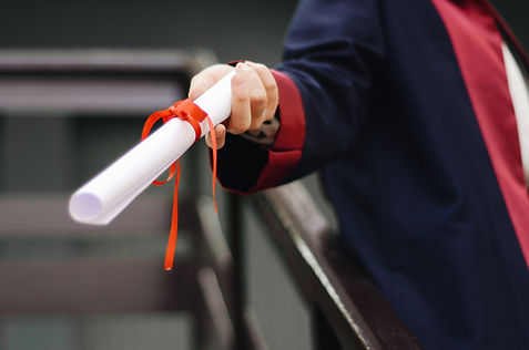 person-holding-white-scroll.jpg