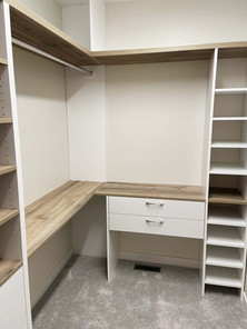 Closet organizer, designed, installed, built to save space by Wood Products Unlimited