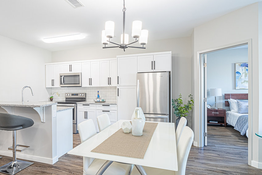 Modern, white kitchen cabinets. Designed, built by Wood Products Unlimited, Inc.