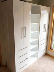 White closet organizer, custom work by Wood Products Unlimited