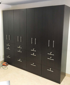 Black closet organizer, custom work by Wood Products Unlimited