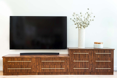 Custom millwork, brown furniture for living room by Wood Products Unlimited