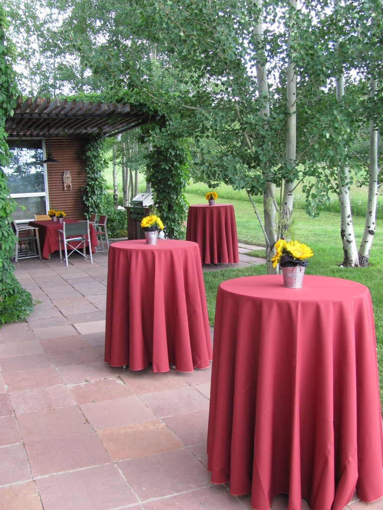 Cocktail tables with brick colored linen