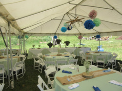 Outdoor wedding set up under a 20' x 30' frame tent