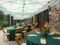 """48"""" rnd. tables, natural wood chairs, specialty linen"""