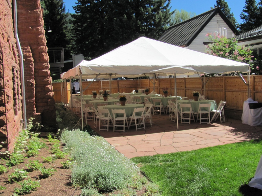 "20' x30' frame tent, 60"" rnd. tables, white wood chairs, specialty linen"