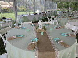 Mint green and burlap table covers for wedding reception