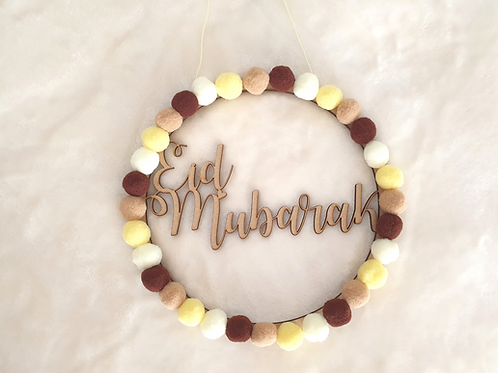 Wooden Eid Mubarak name hoop wall decor cream beige brown felt balls Abu Dhabi Dubai Al Ain Gateway Art Sales LLC