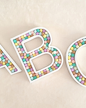 Pretty freestanding letters numbers filled with colourful pom poms. Choose initials, names or meaningful words with your favourite colours for personalised gifts and home decor. Ideal nursery kids girls boyrs room decor for sale in Abu Dhabi Al Ain Dubai UAE Gateway Art Sales LLC