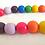 Rainbow wood bead garland with tassel and wooden embellishment decor Abu Dhabi Dubai Al Ain UAE Gateway Art Sales LLC