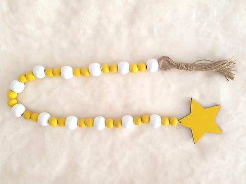 Summer sunshine wood bead garland jute tassel star yellow white decor Abu Dhabi Dubai Al Ain Gateway Art Sales LLC