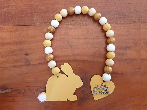 Easter bunny wood bead garland pom pom tail hand painted Abu Dhabi Al Ain Dubai  decor Gateway Art Sales LLC vintage mustard