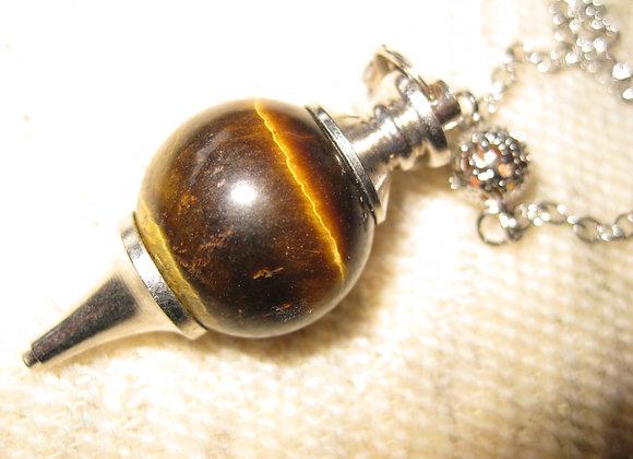 Pendulum i krystallen tigerøye