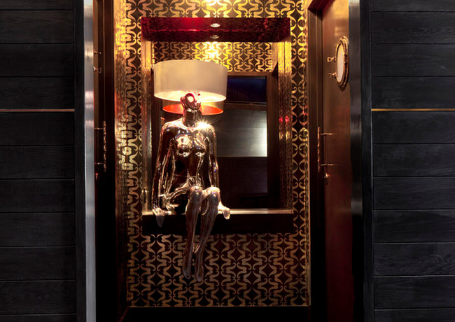 Steel-plated mannequin at the unisex restroom area