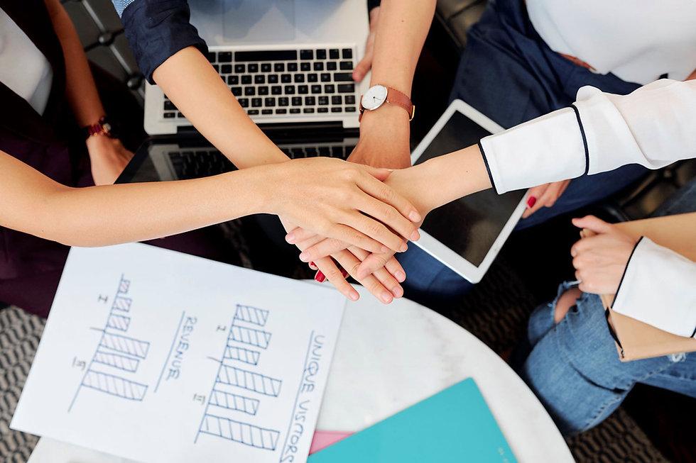 businesswomen-stacking-hands-NNKJSW4.jpg
