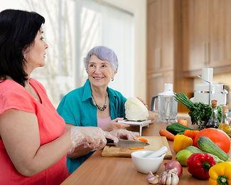 Female caregiver or volunteer and senior