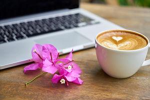 Canva - White Ceramic Teacup Beside Lapt