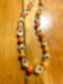 Hamsa Red Orange Glass Bead Close up.jpg