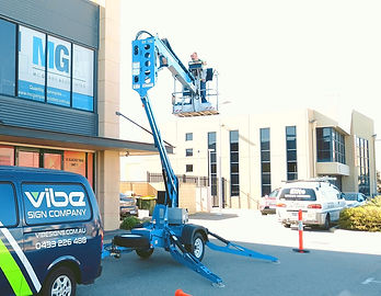 Sign removal with cherry picker