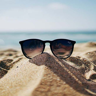 beach-black-ray-ban-wayfarer-sunglasses-on-beach-sand-sunglasses-sunglasses-image_edited.jpg