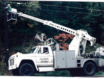 This is a bucket truck! Just one of the many company vehicles we have had over the years.
