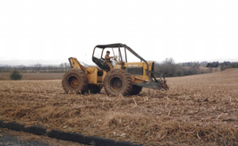 President, Bryan Wright, at the age of 7 driving a Skid Steer in Williamsport PA for a job!