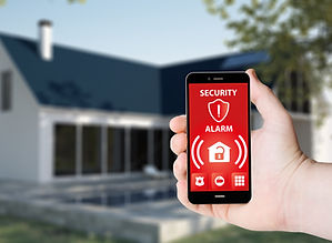 Hand hold a phone with security alarm ap