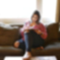 sabrina joy sitting on couch journaling