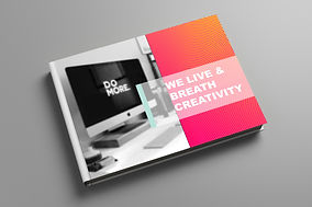 Image of a book cover. The right side of the book has white writing on a pink ground that says we live and breath creativity. The left side of the book has a picture of a computer screen that says do more.