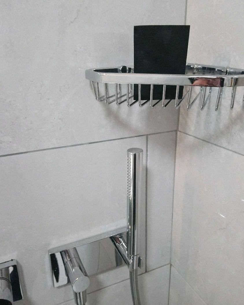 charcoal soap drying in minimalist shower