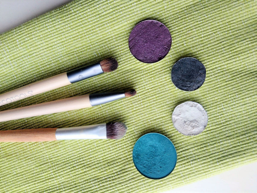 handmade purple, white, black, blue vegan eye shadows with bamboo brushes