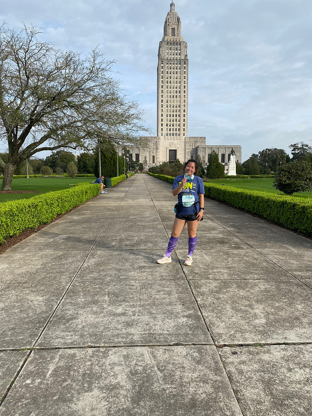 Laura Siu resting from a run in front of the Baton Rouge State Capital.