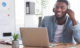 smiling-employee-in-headphones-watching-webinar-on-SURT45B.jpg