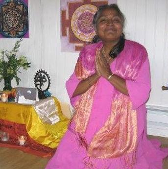 Sree pink dress-kneeling at altar-Naropa