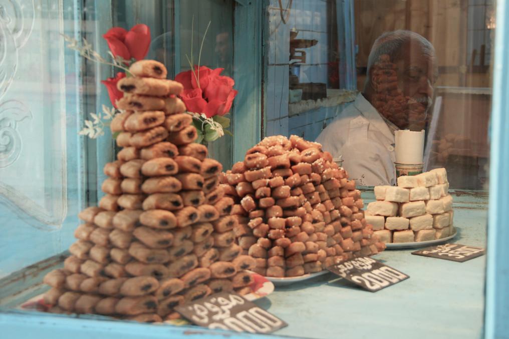 S2-13 Kairouan Man behind sweets.JPG