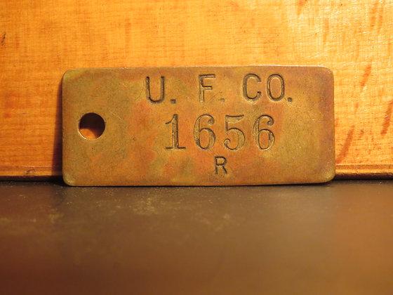 UFCO Brass Inventory Tag E1656
