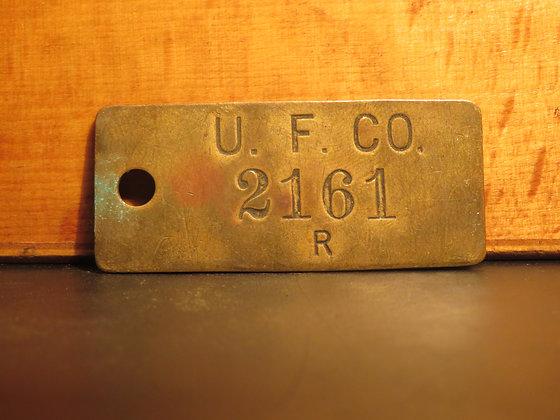 UFCO Brass Inventory Tag E2161