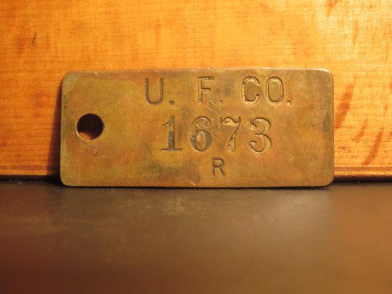 UFCO Brass Inventory Tag E1673