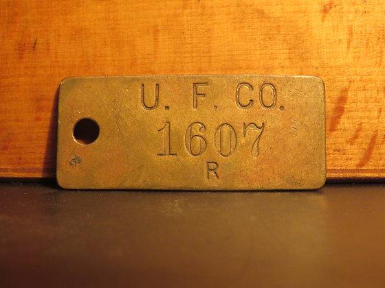 UFCO Brass Inventory Tag E1607