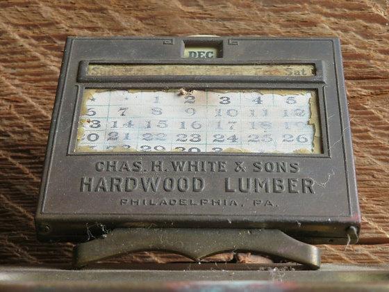Chas. H. White & Sons Hardwood Lumber Brass Desk Calendar