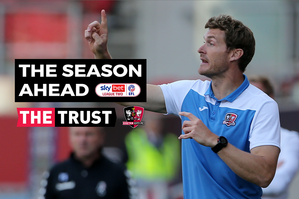 Matt Taylor instructs his players, with the words 'The Season Ahead' and the Supporters' Trust and football club logos superimposed.