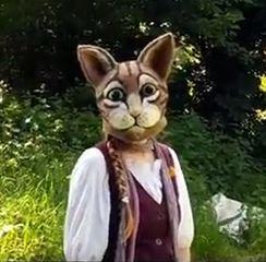 woman wearing full head cat mask in needle felted wool