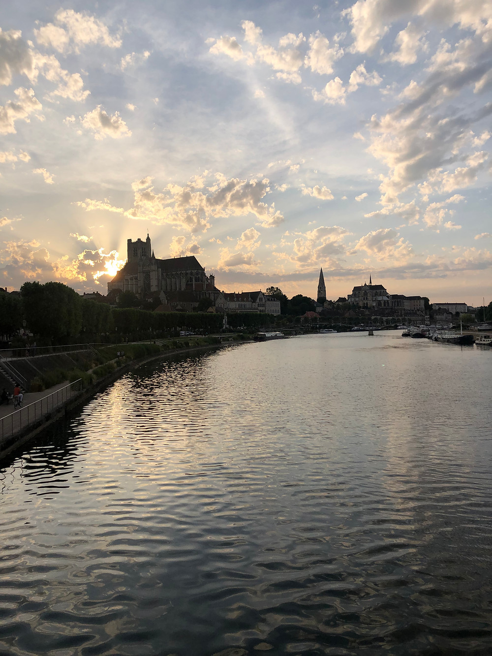 Yonne river in Auxerre at sunset with a view of Saint Germain abbey